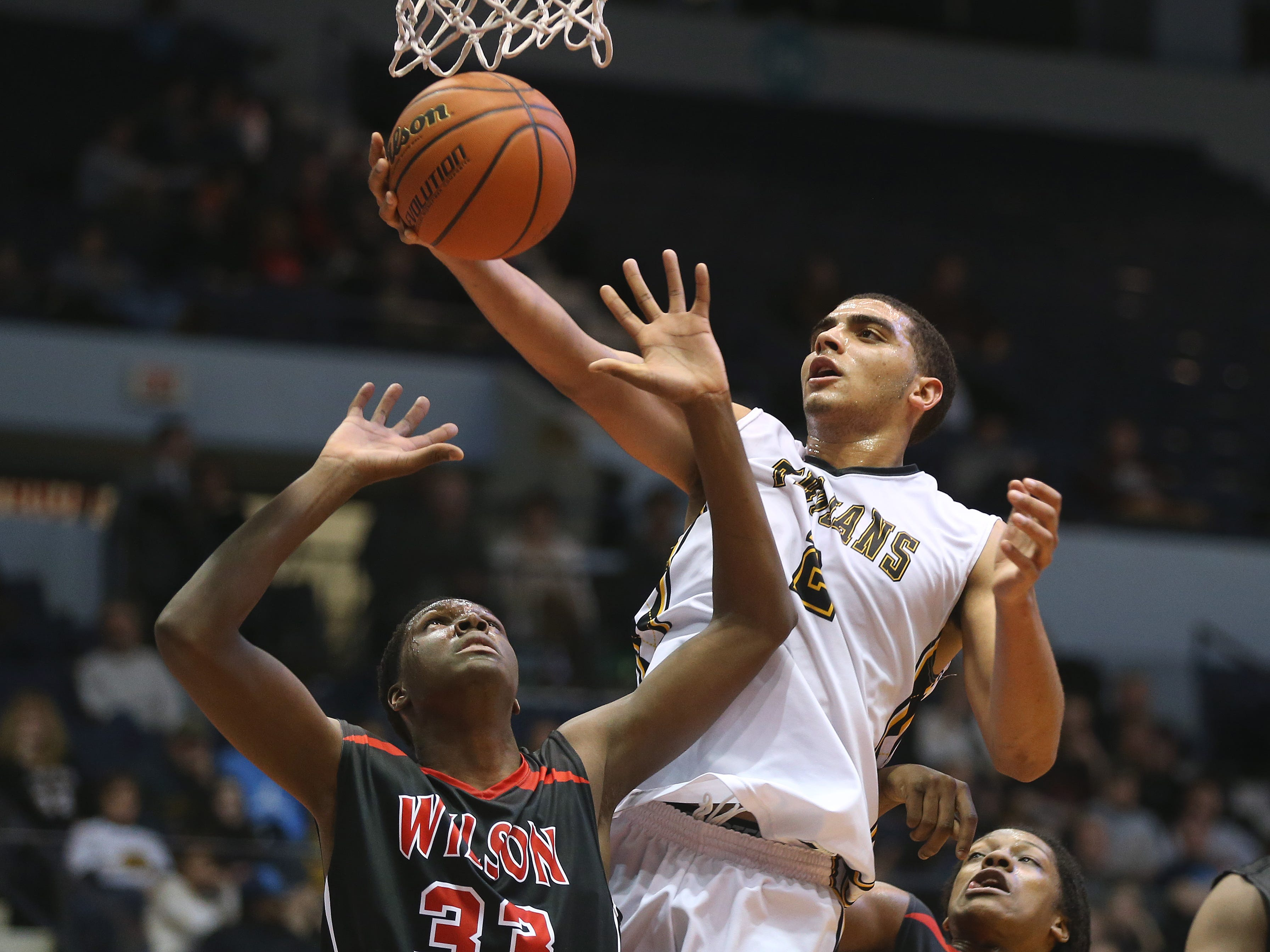 Athena's Anthony Lamb (2) pulls in a rebound over Wilson's Deandre Adullah (33).