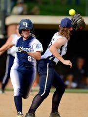Dallastown's Maggie Noll safely crosses first while