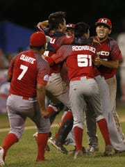 Players from Tijuana, Mexico, celebrate their 6-5 victory
