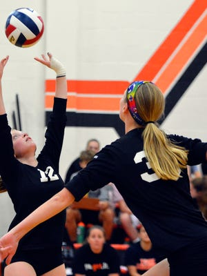 York Suburban's Lauren Guyer sets the ball for teammate Nat Saxton during a match last season. They are key players on the 2018 Suburban team that is ranked No. 5 in the state in Class 3-A by the Pennsylvania Volleyball Coaches Association.  John A. Pavoncello photo