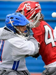 Susquehannock's Adam LeBlanc collides with Spring Grove's Madison Moore during lacrosse action at Spring Grove Thursday, April 19, 2019 Bill Kalina photo