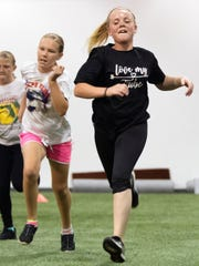 Kaylee Lambert, 12, right, trains on Wednesday at Cape Coral Indoor Athletics. The facility opened this month and features multi-sport performance training, summer camps, batting cages and speed and conditioning classes.
