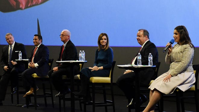 Candidates, from left, Rocky Raczkowski of Troy, state Rep. Klint Kesto, former U.S. Rep. Kerry Bentivolio, Kristine Bonds of West Bloomfield, Plymouth Township supervisor Kurt Heise and Lena Epstein of Bloomfield Hills discuss the issues Monday at the 11th District debate in Novi.
