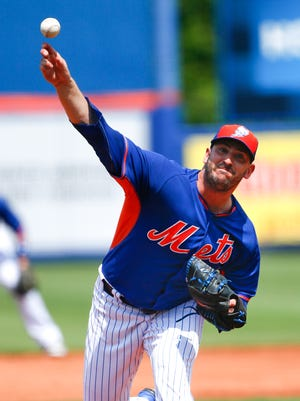 Mets starting pitcher Matt Harvey works in the second inning of an exhibition spring training baseball game against the Yankees on Sunday in Port St. Lucie, Fla.
