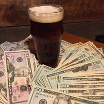 Two large craft beer breweries in California are selling to international corporations, igniting a debate about what constitutes craft beer and raising philosophical questions within the industry about priorities.
