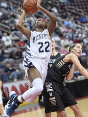 Lebanon Catholic's Neesha Pierre goes in for two of her 18 points at Giant Center on Thursday.