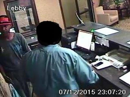 Jackson police are looking for the man at left, in the gray shirt and baseball cap, in connection with a robbery Sunday at the Comfort Inn.