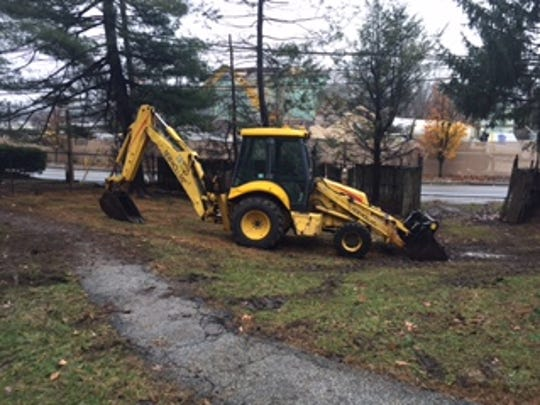 Bulldozer that recently took down an outbuilding at historic Washington hq site