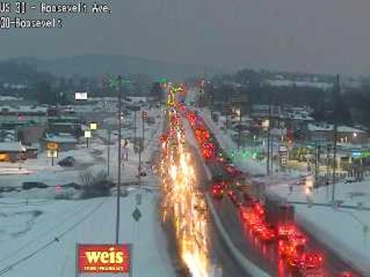 Traffic along Route 30 has slowed to a crawl because of slick conditions and narrow lanes.