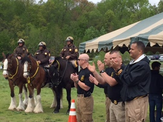 """The Mounted Patrol Unit is pictured at Glasgow Park Fishing Pond during the first """"Casting with Cops"""" event on Saturday, April 30. The event paired county police with young anglers and kicked off the opening of the fishing pond."""