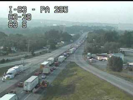 Southbound traffic on I-83 is backed up around the Strinestown exit on Friday.
