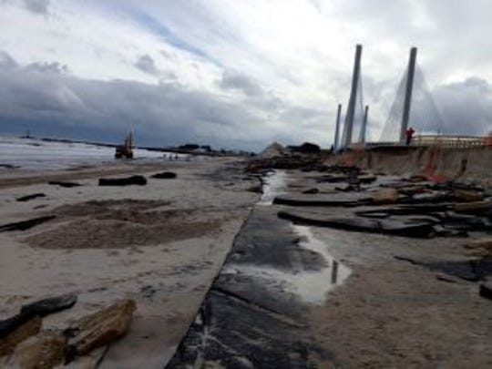 The north side approach road to the old Indian River Inlet Bridge was destroyed during Hurricane Sandy. The new bridge in in the background.