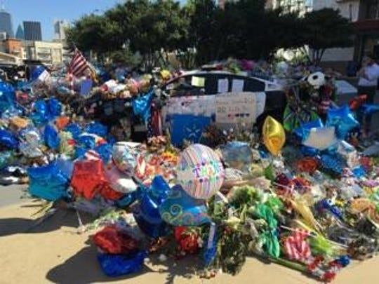 Tributes line the patrol car of Sgt. Michael Smith at his funeral in Dallas.