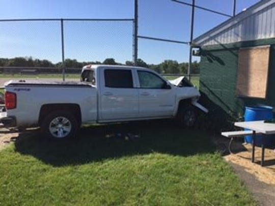 Authorities said Sunday, Sept. 18, that the driver of this pickup allegedly hit two men before driving in to this concession stand at a north Des Moines softball field.