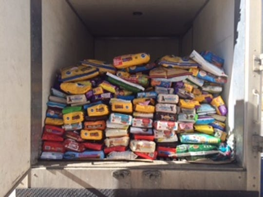 It took a truck to deliver the half ton of food for Lincoln County Humane Society shelter animals collected over the past three weeks by RMS students.
