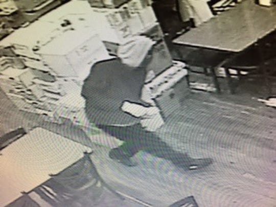 Police have released surveillance images of the suspects