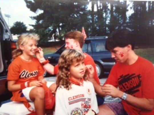 They are of me, my cousin (Lindsay Taylor), and my sister (Callie Crawford), as we were getting our faces painted with Tiger paws before the game
