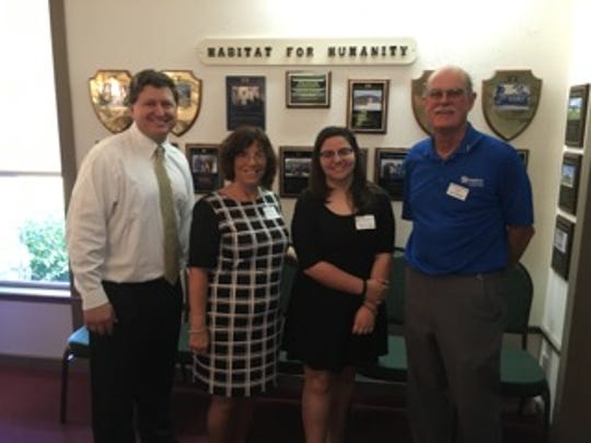 Left to right: Rev. Mark Williams of United Church of Marco Island, Joanna Scalora, her daughter Angelica, and Curt Gillespie of Habitat for Humanity.