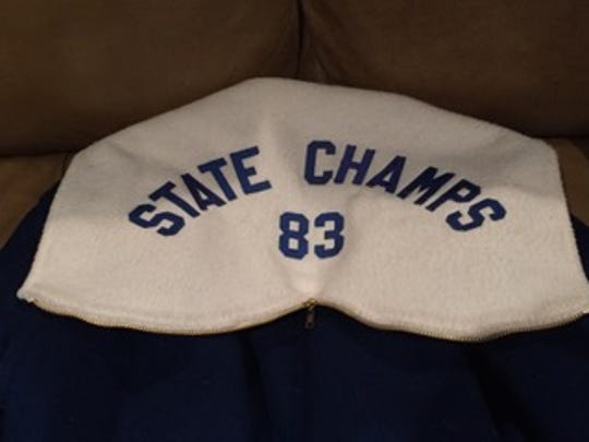 The last time Covington Catholic's swim team won a state title was 1983. This is a jacket commemorating the accomplishment.