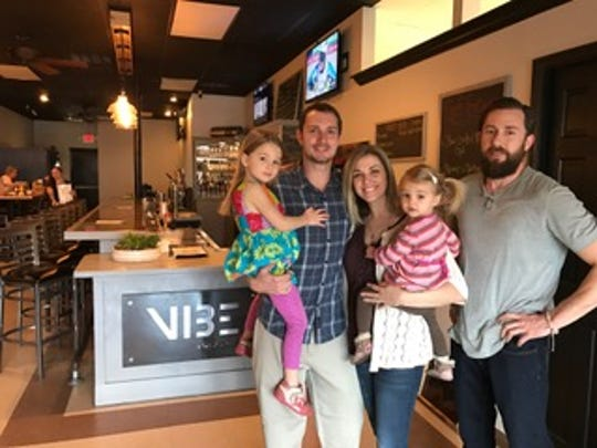 Vibe owner Mitch Fletcher (center left) imagines a unique dining and drinking experience for locals. He and his family, including (from left) 4-year-old Cali, wife Andrea, 2-year-old Reese and brother Oakes, worked together to realize Fletcher's dream.