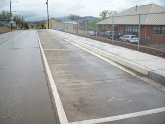 Cooper Street improvements include on-street parking, a new wall in front of El Grito School and new ADA-compliant sidewalks.