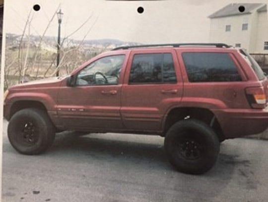 John Lynn was driving a maroon Jeep Grand Cherokee