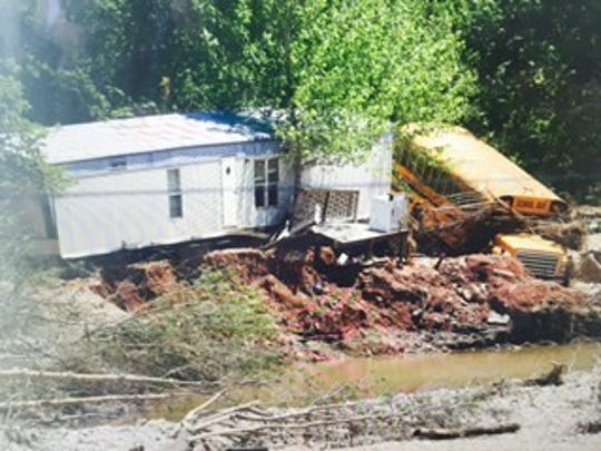 Flood damage is seen Friday in Eminence.