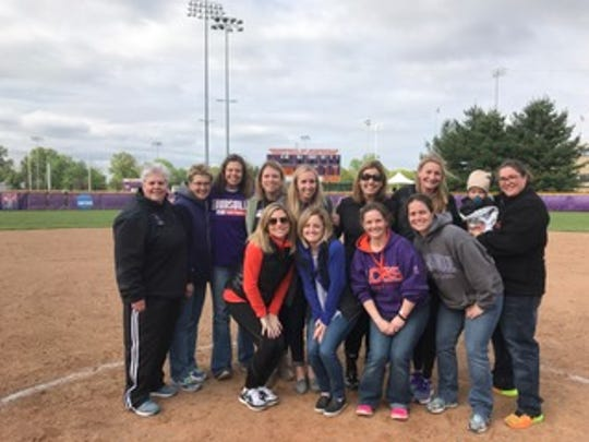 Members of the 2002 University of Evansville softball team and their coach, Gwen Lewis, recently gathered for a reunion on campus.