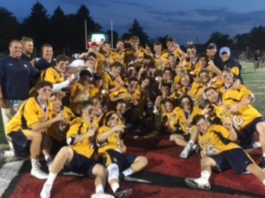 Moeller poses with the state lacrosse trophy.