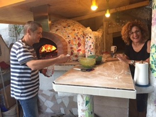 A wood-fired oven on the patio where Meschini's brother,