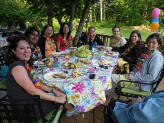 A group of women enjoy the spread at 10Fitch in Auburn.