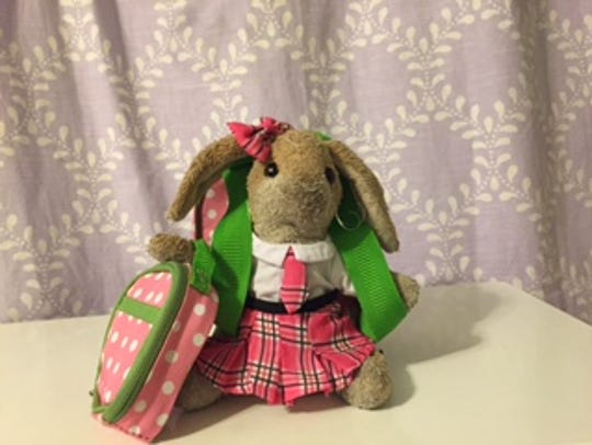 Spotty, a much-loved bunny in our house, is dressed