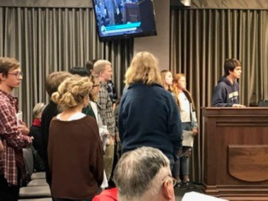Zak Hudspeth, a member of the Youth for Environmental Stewardship, speaks in favor of 100 percent renewable energy at the Dec. 5 Buncombe County Commissioners meeting.