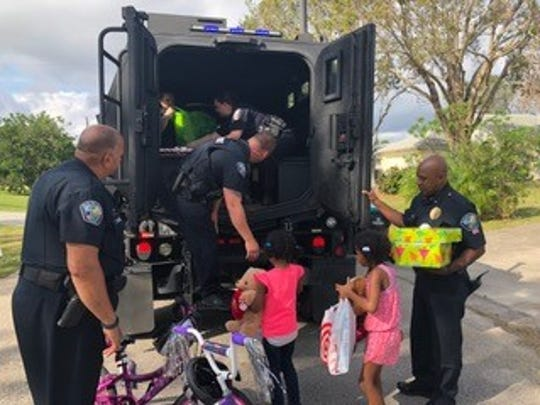 Palm Bay officers acting in the tradition of giving