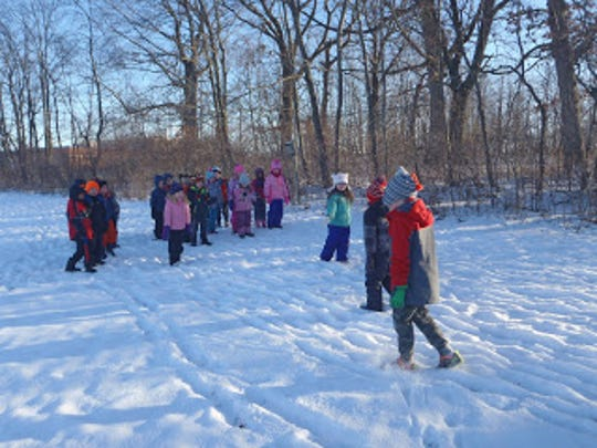 Students in Peter Dargatz's class at Woodside Elementary School prepare to take their knowledge of penguins and apply it outside during a class Jan. 5.