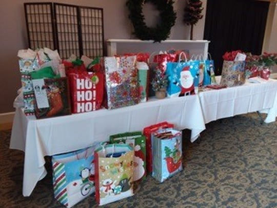 This year, 167 parishioners of Holy Family Catholic Church each donated at least $50or more for a gift bag for homeless and needy children who attendlocal schools. The gift bags each containa pair of sneakers, a week'sworth of socks, underwear and a $10 Walmart gift card.