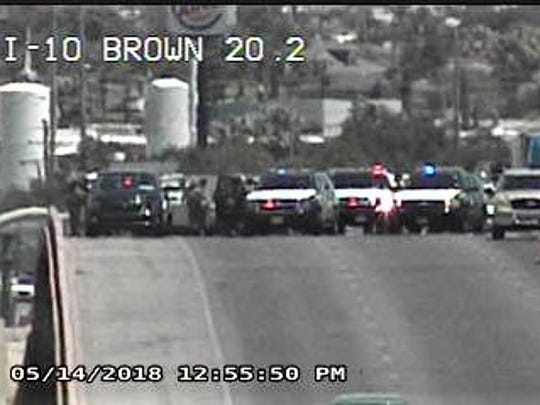 Law enforcement vehicles block Interstate 10 West east of Downtown El Paso in this image from a Texas Department of Transportation traffic camera.