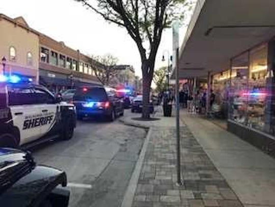 Waukesha police vehicles line W. Main Street between