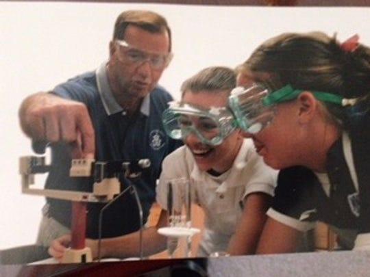 Larry Borcherding teaches in Mother of Mercy High School's chem lab.