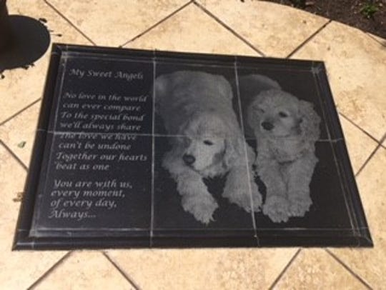 A memorial to Cathy Cuni's previous dogs is located