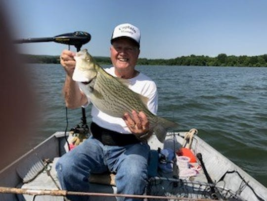Columnist Manny Luftglass hold a nine-pound hybrid