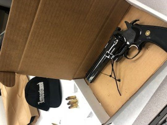 A stolen gun reportedly found in the possession of