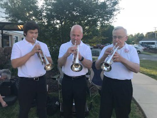 The 2018 re-creation of the trumpet trio shows Joichiro Long, Joseph Long, and Chuck Long.