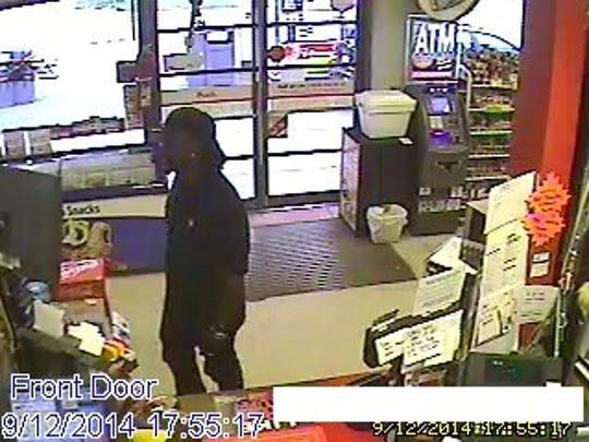 Mickey Mart suspect at counter at 5:55 p.m. Friday.