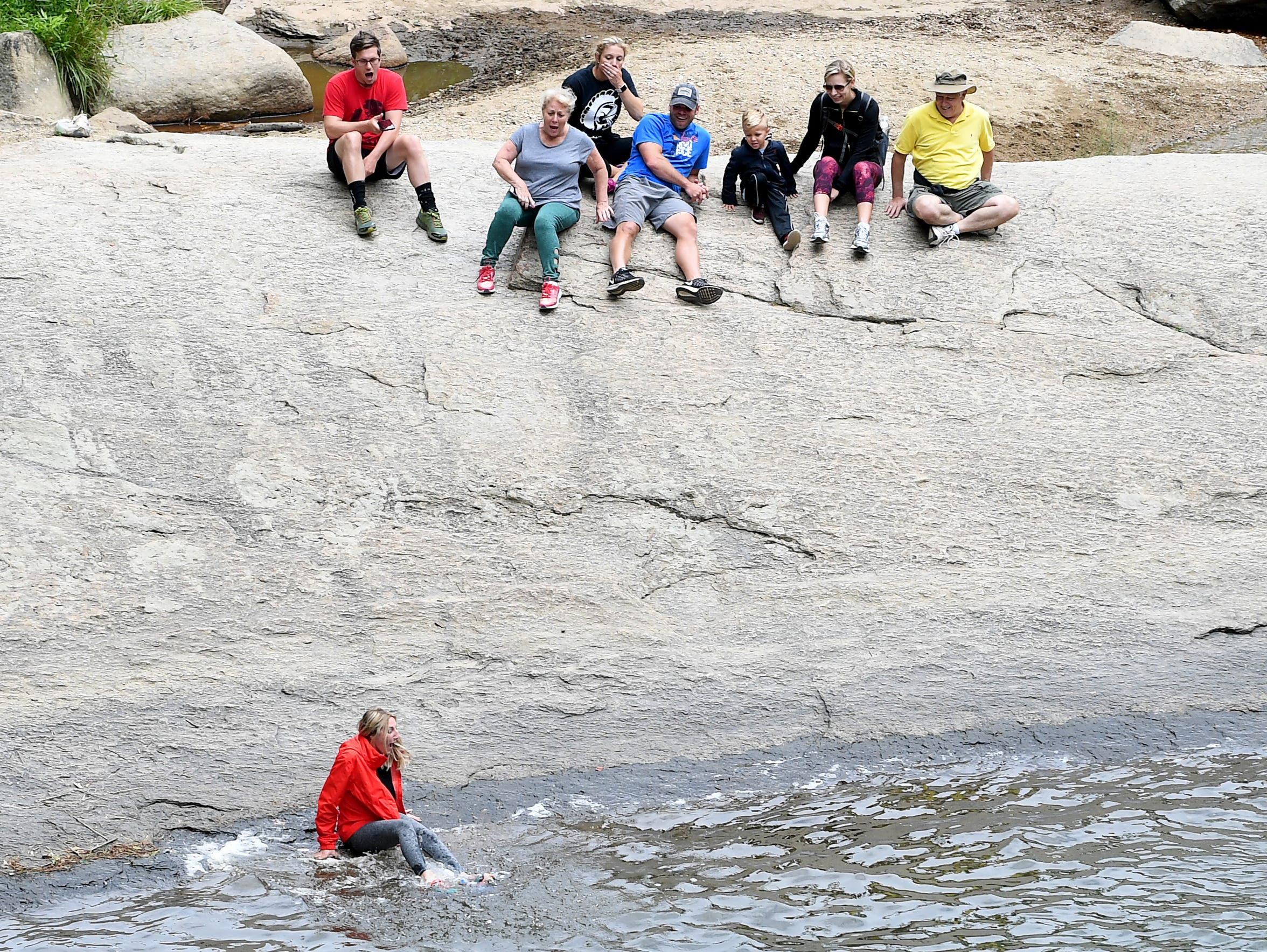 A woman slips into the water at the base of Elk River