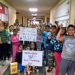 Students at North Dover Elementary School in Dover collected more than 800 canned and dry goods to benefit the Dover Food Pantry. The drive was organized third grade teachers Kristen Tiedemann, back row, left, Andrew Lazar, back row, right, and music teacher Donna Shroeder (not pictured).