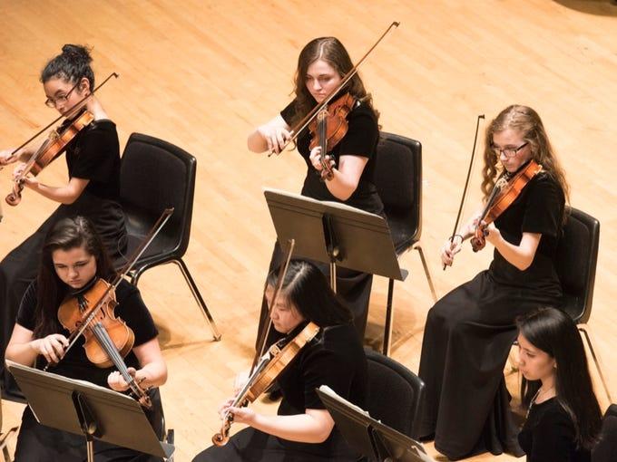 The David Douglas High School Symphony performs at