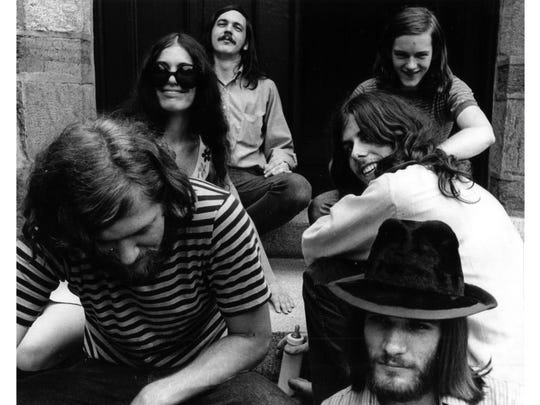 Jeff Bove's band Martha Lidd, an area favorite in the late '60s, sits on the steps of Immanuel Church in Wilmington. Bove is wearing the striped shirt.