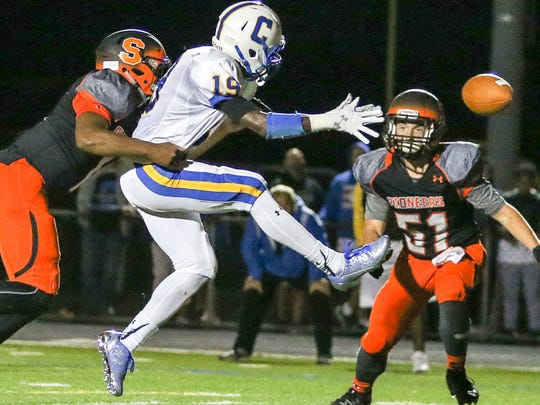 Cranford's Joshua Cadet can't reach a pass under coverage from Somerville's Jalahn Dabney, left, while in the end zone at Somerville on September 8, 2017. (Photo by Keith Muccilli, Correspondent)