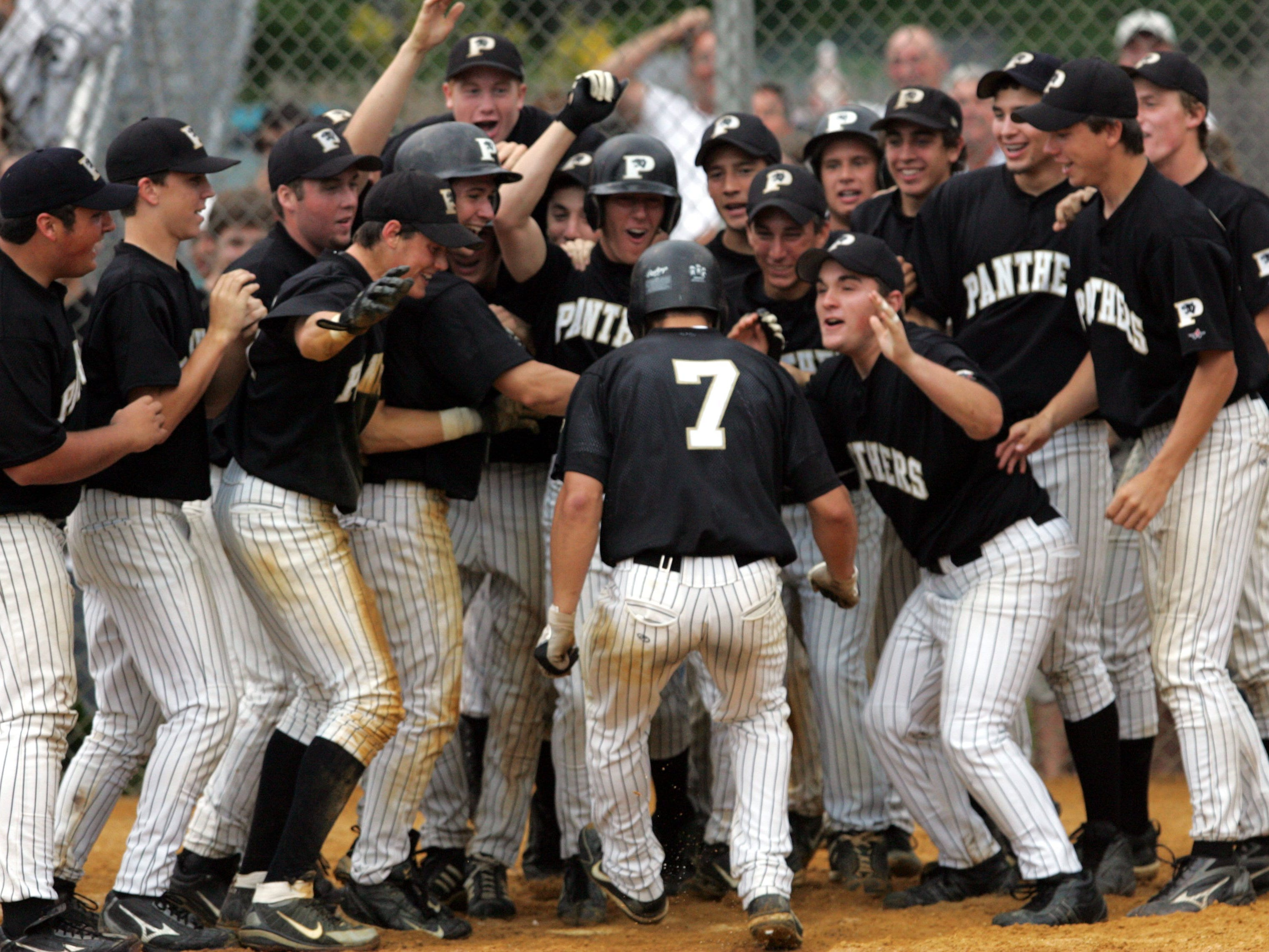 Point Boro's Pat Biserta is greeted at home plate and a grand slam in a 2006 state tournament game against Delran. Biserta hit 17 career home runs for the Panthers.